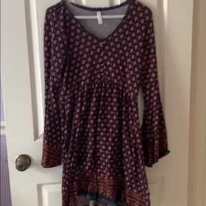 Maroon dress with tons of fun designs all over